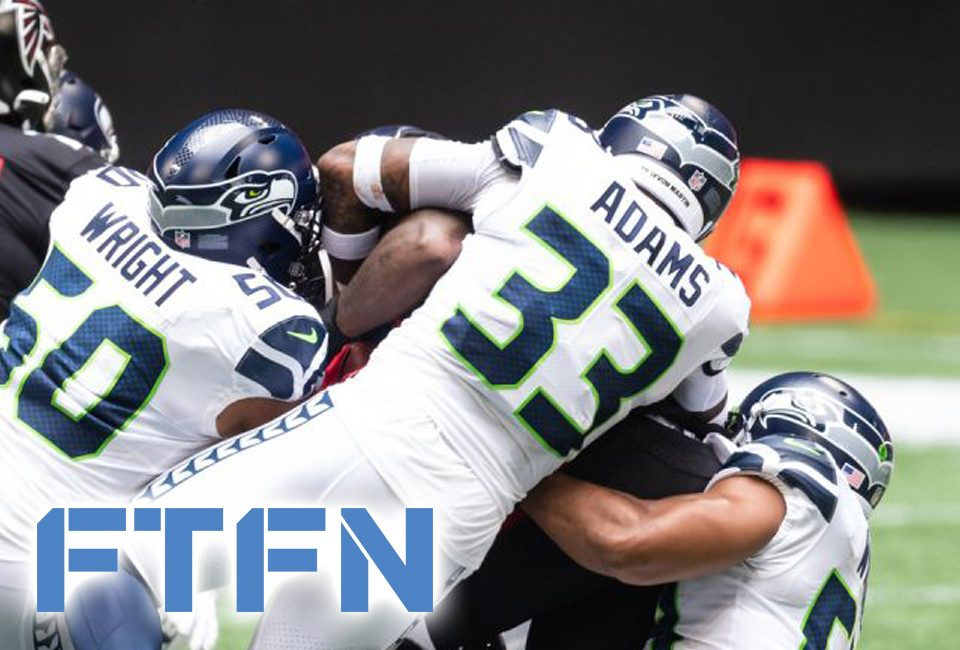 Seahawks KJ Wright and Jamal Adams combine for a tackle